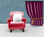 Red leather chair with a white pillow in floral interior Royalty Free Stock Photo