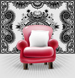 Red leather chair with a white pillow in interior Royalty Free Stock Photos