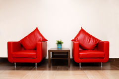 Red leather chairs with pillow Royalty Free Stock Photos