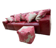 Red leather couch and puff. Isolated Royalty Free Stock Images