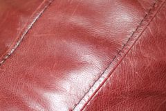 Red Leather Couch. Zoomed in image of a red leather couch Royalty Free Stock Photo