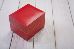 Red leather covered box on white wooden boards Royalty Free Stock Photo