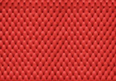 Red leather cushion with many holes Stock Photography