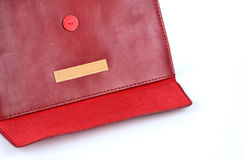Red leather envelope case with Velcro Stock Images
