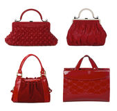 Red leather female bags isolated on white Royalty Free Stock Photos