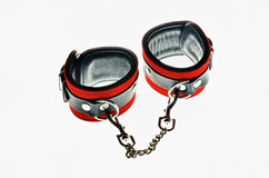 Red leather handcuffs royalty free stock image