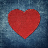 Red leather heart on fabric in grunge style Royalty Free Stock Photos