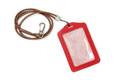 Red leather label tag with string, isolated on the white backgro Royalty Free Stock Photo