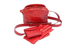 Red leather lady bag, gloves and purse. Isolated on white with clipping path Stock Photography
