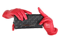 Red leather lady gloves and black. Purse, isolated stock images