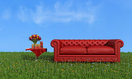 Red leather luxury sofa on grass Royalty Free Stock Images