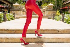 Red leather pants and high heel shoes stock photo