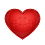 Red leather pillow as heart Stock Photos