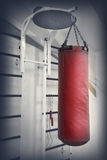 Red leather punching bag Royalty Free Stock Photo