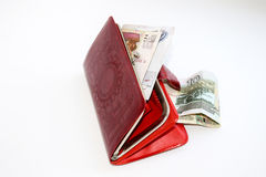 Red leather purse with money.  Stock Photo