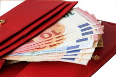 Red leather purse with money Royalty Free Stock Photo