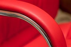 Red leather recliner, closeup detail, skin texture stock photography