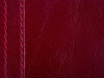 Red  leather . Red leather seam. Red dressed leather . Red leather seam. background leather Stock Images