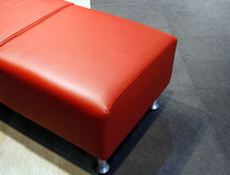 Red leather settee Stock Photos