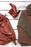 Red leather shoe and satchel. Bright wood background Royalty Free Stock Photos
