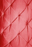 Red leather sofa background. Stock Image