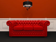Red leather sofa with chandelier interior Royalty Free Stock Photography