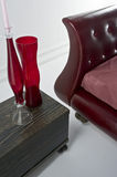 Red leather sofa with glass Stock Images