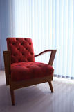 Red leather sofa in living room with curtain and l Stock Photos