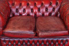 Red leather sofa. Red Old Vintage genuine leather Sofa Texture Background stock photography