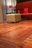Red leather sofa on the parquet floor. Sofa on the parquet floor Stock Photography