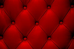 Red leather sofa texture. As background Royalty Free Stock Photography