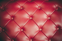 Red leather sofa textures backrest. Red leather sofa textures backrest Royalty Free Stock Photos