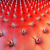 Red leather spike design upholstery Stock Images