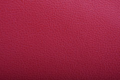 Red leather surface Stock Photos