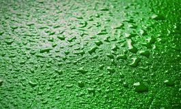 Blue leather surface in droplets of water. stock photos