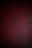 Red leather texture. Macro shot of a dark red leather textured background Royalty Free Stock Image