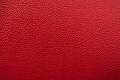 Red leather texture background. Luxury genuine textile surface material wallpaper with furniture backdrop. Close up of fashion. Fabric, sofa, textured, copy royalty free stock photo