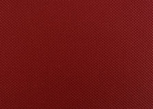 Red leather texture closeup, useful as background. Royalty Free Stock Photos