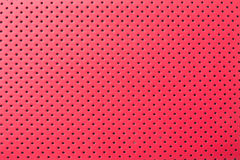 Red leather texture. With perforated holes Stock Photo
