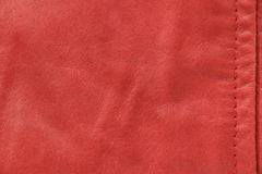 Red leather texture with seam Stock Photo