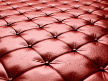 Red leather upholstery chesterfield style background Royalty Free Stock Images