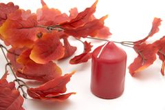 Red leaves and candle Stock Photos