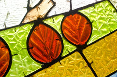 Red leaves in stained glass window. Abstract geometric colorful background. Stock Photography