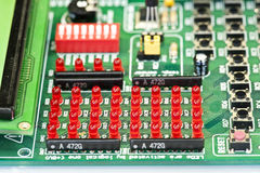 Small leds for circuit board. Red leds on the circuit board with components royalty free stock image