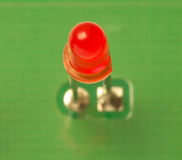 Red LED indicator. Red LED on the green background of the PCB Stock Photo