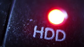 Red LED status lamp blinking through recording data on pc hard drive, close up stock footage