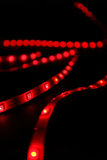 Red leds. Led red stripes on black background royalty free stock photo