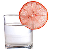 Red lemon slice on a glass of water Royalty Free Stock Photos