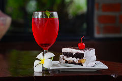 Red lemon soda on glass and bakery.  Stock Image