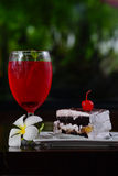 Red lemon soda on glass and bakery.  Stock Photos